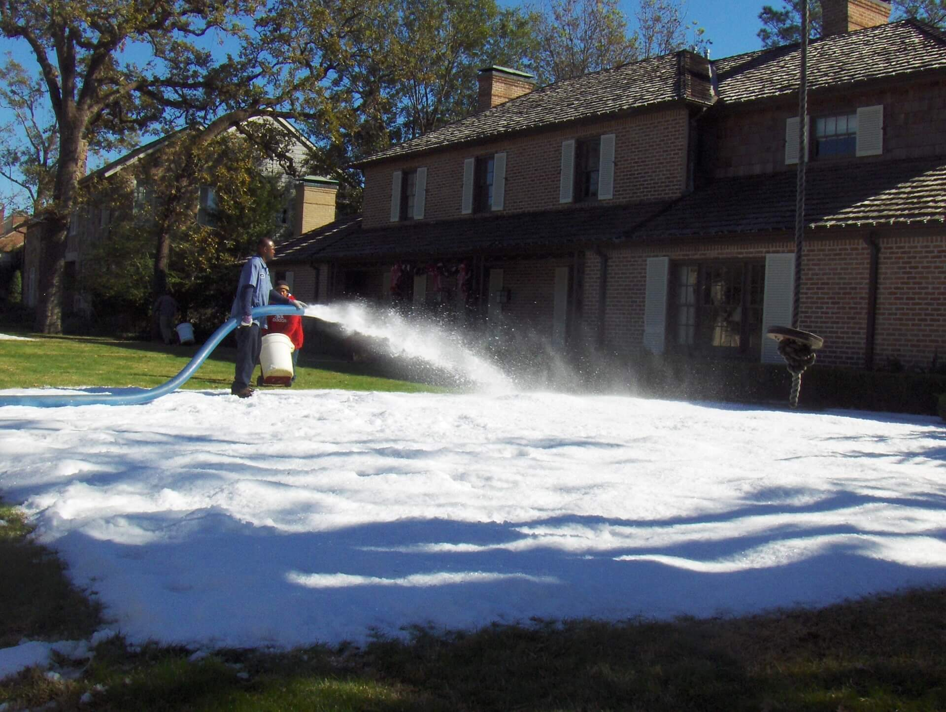 making-snow-in-houston-home-front-yard